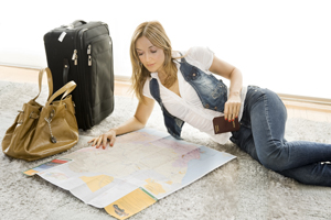 beautiful woman planning her trip using a map